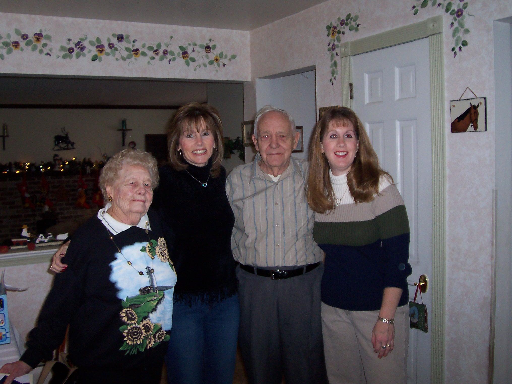 Charles, Virginia & grandchildren, Marilyn (left) & Lorie (right) Christmas 2003